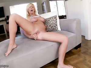 Blonde Tasha Reign poses invitingly before masturbating