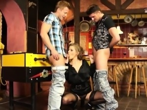 Stunning wench gets to pleasure two rods