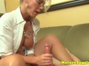 Mature handjob milf in spex uses both hands to tug
