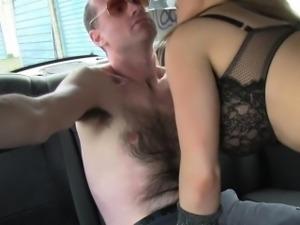 Busty female cab driver punishing guy