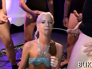 Sexy beauty acquires wet pissing from guys during filming