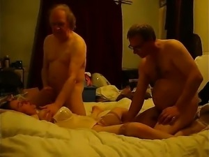 Nasty husband sharing his lustful brunette wife with his be
