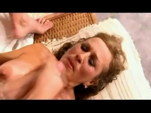 Naughty GILF takes hard young cock
