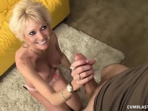Short haired blonde lady with amazing big boobs jerks off a long dick