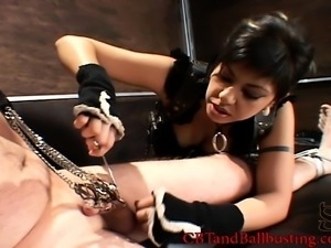 Dominatrix teases her slave with some head after she spikes it