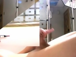 Massive cock gets handled by a tgirl hand and cums hot jizz