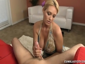 Provoking blonde housewife with big breasts delivers a sensual handjob