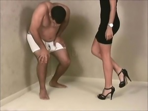 Latina in a black dress punishes her slave by stepping on h