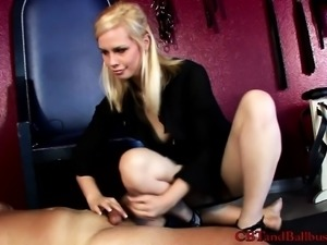 Blonde handles her masked man's pecker and stands on it in heels