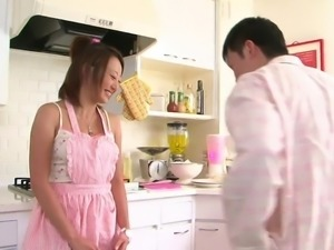 Cute Asian babe loves to suck cock in the kitchen