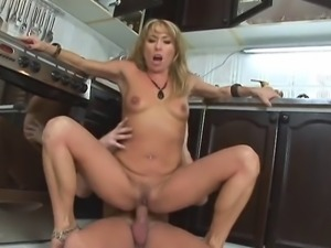 MILF and young man in kitchen