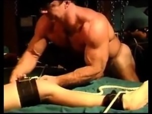 Bodybuilder ties smaller guy to bed - BDSM
