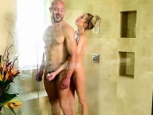 Kinky big boobed masseuse seduces client in the shower