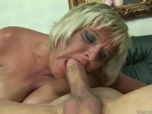 Granny was lying nude on sofa. I saw her masturbating, and felt horny. I...