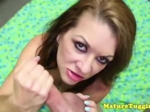 Busty mature jerking and tittyfucking