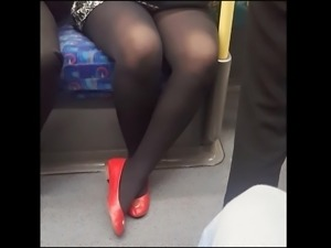 Black pantyhose girl with flats in metro