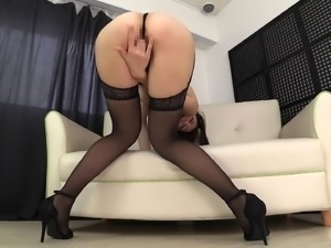 Asian senorita in black lingerie shows off her sexy private parts