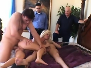 Luscious blonde wife takes a double pounding and succumbs to pleasure