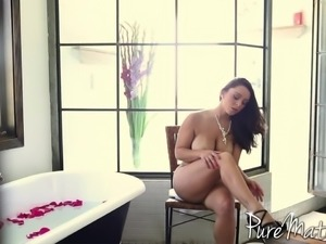 Beauty in a rose petal bath offers him anal sex in bed