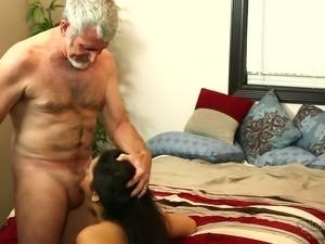 Raven haired slutty GF sucks sweet penis of 75 years old man with pleasure