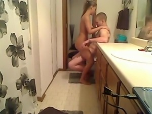 Busty Girl Gets Fucked in The Bathroom of The Parents' Room