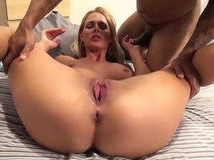 Slender blonde with sexy long legs fucks a black stick and cums hard