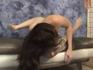 Brunette Maci May Lies Down On Couch For Face Bashing