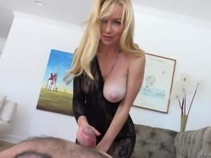 Stunning blue-eyed blonde Kayden Kross displays her pink pussy and shapely...