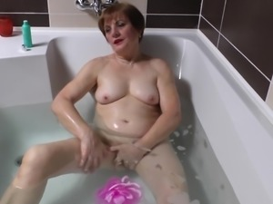 Horny granny decides to spice up her bathroom time with masturbation