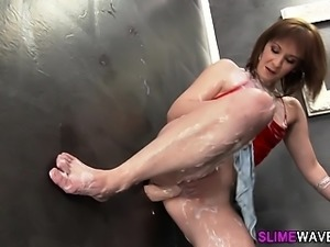 Gloryhole slut rides toy
