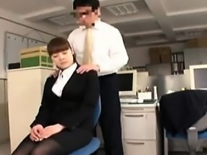 Luscious secretary with perky boobs kneels down and blows a