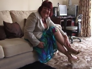 Chubby grandma models her sexy stockings and panties for us