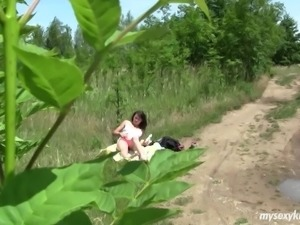 Highly erotic brunette teen getting naked and masturbating outdoors
