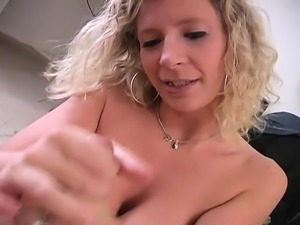 Curvaceous blonde cougar Sara using her hands to please a long prick