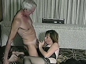 A girl in stockings and lingerie has sex with old man