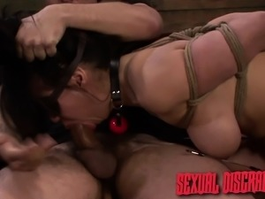 Buxom brunette Kimmy Lee satisfies her lust for bondage and hard cock