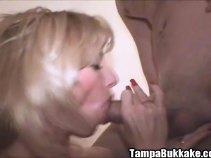 Sexy slim blonde in stockings Holly enjoys an exciting bukkake party