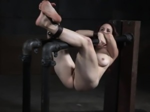 Tit bondage slave gagging on a big dildo