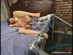 Mika Tan the slim Asian babe gets toyed by a machine in a bedroom