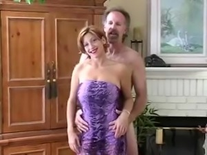 Slutty MILF with hanging boobs gives a blowjob to her hubby