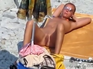 Young and sporty stranger hottie on the beach filmed sucking dick