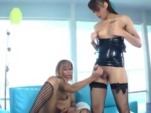 Foxy shemale in latex lingerie getting his asshole drilled with a dildo