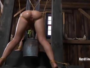 BDSM shoot showcasing bondage dame juicy pussy seductively