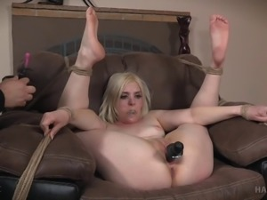 Pretty girl flogged and fondled as she sits in rope bondage
