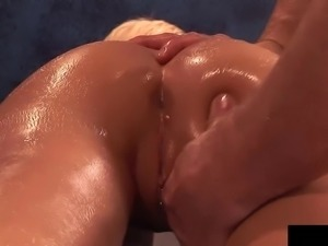 Oiled blonde beauty with an arousing body nailed in the massage parlor