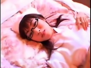 Provocative nurse with glasses sensually exposes her wonder
