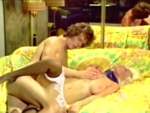 Hot and busty classic blonde milf with skinny guy on the bed