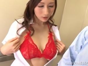 Beautiful Japanese nurse in glittering red bra having her big tits caressed...