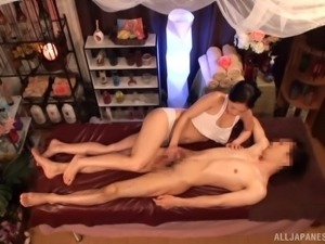 Breathtaking masseur from Japan plays with the boner after the massage