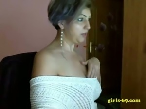 Curvaceous GILF fooling around and masturbating on webcam